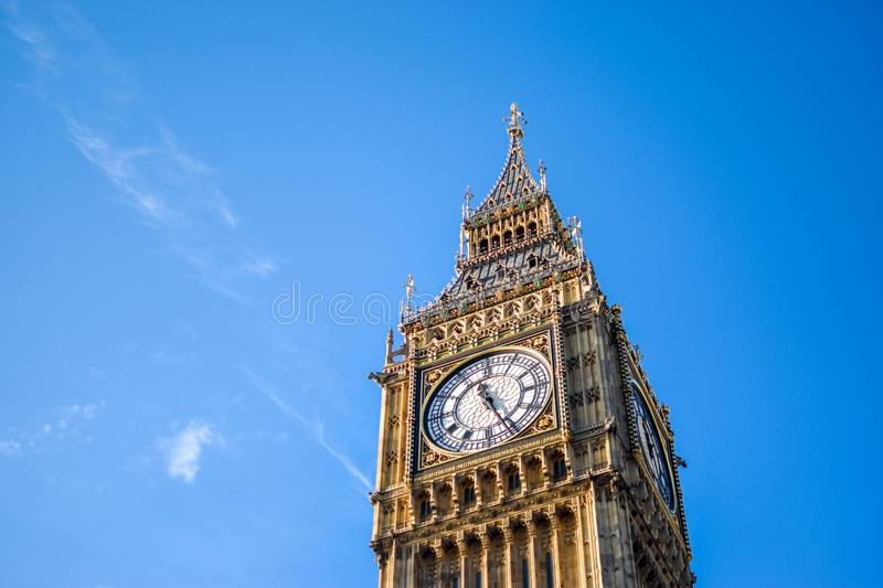 Low Angle View of Clock Tower Against Blue Sky stock photo