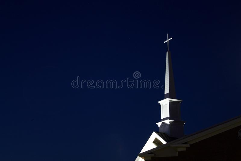 Low Angle View of Cross Against Sky at Night royalty free stock photo