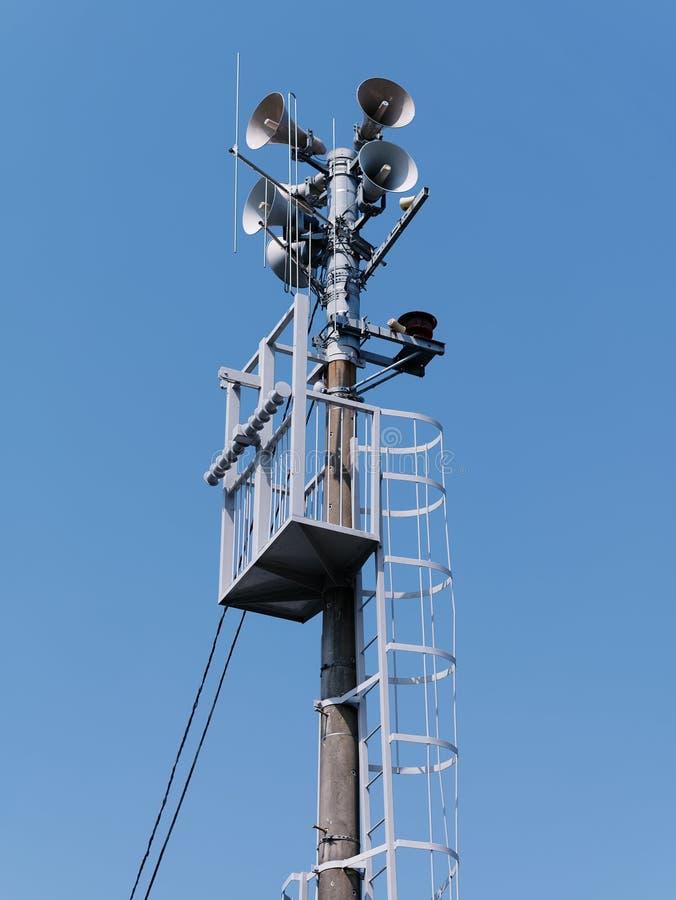 Emergency siren against blue sky background. Low angle view of Emergency siren against blue sky background stock photos