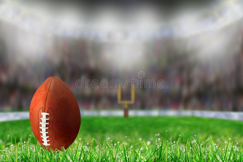 Football on Grass Ready For Field Goal or Kick Off stock images