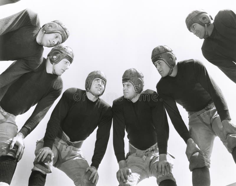 Low angle view of football huddle