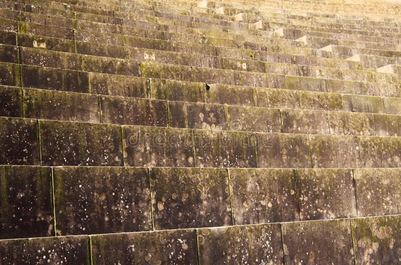 Low angle view, full frame close up of isolated ancient stone steps and seats of roman amphitheater - Xanten, Germany royalty free stock photo