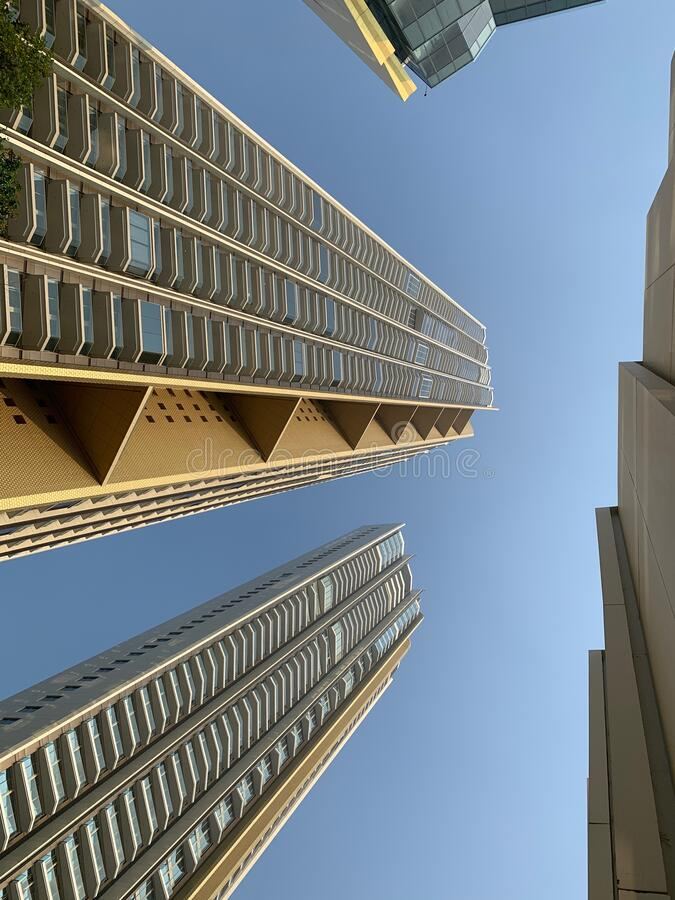 Low angle view of the gold buildings , luxury building under the blue sky stock photo