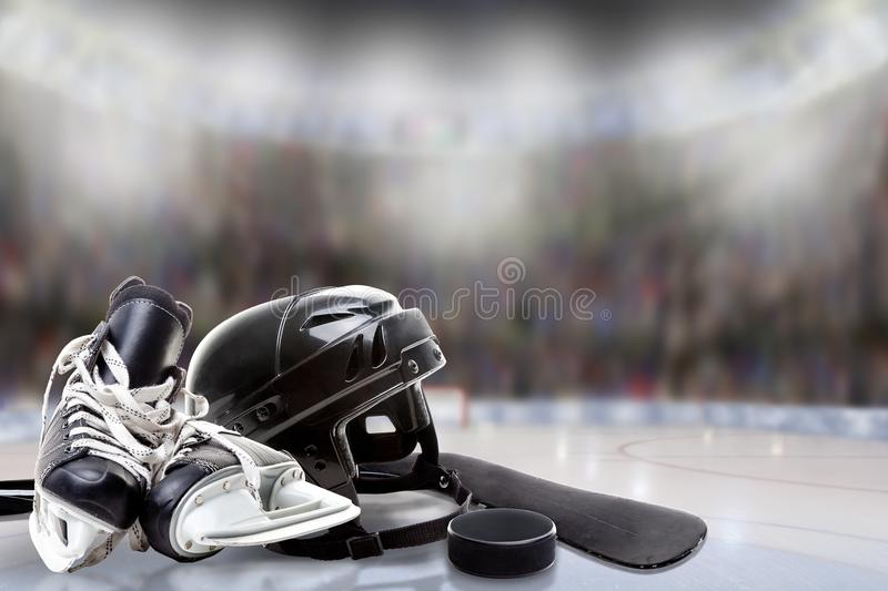 Ice Hockey Helmet, Skates, Stick and Puck in Rink stock photo