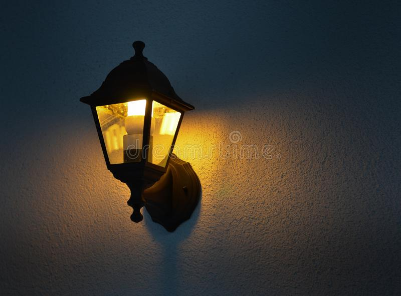 Vintage lamp mounted on wall royalty free stock image