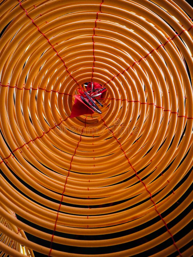 Low angle view on the inside of a large yellow incense coil hanging from the ceiling in a Chinese temple stock photos