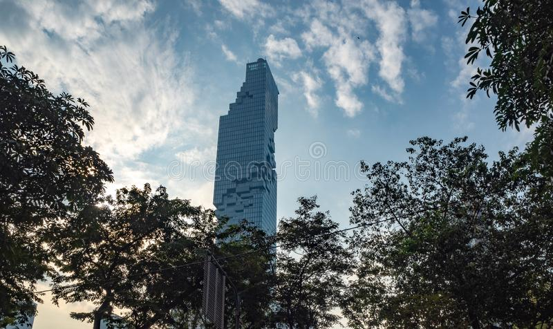 Low angle view residential building on blue sky with clouds in the evening background royalty free stock photo