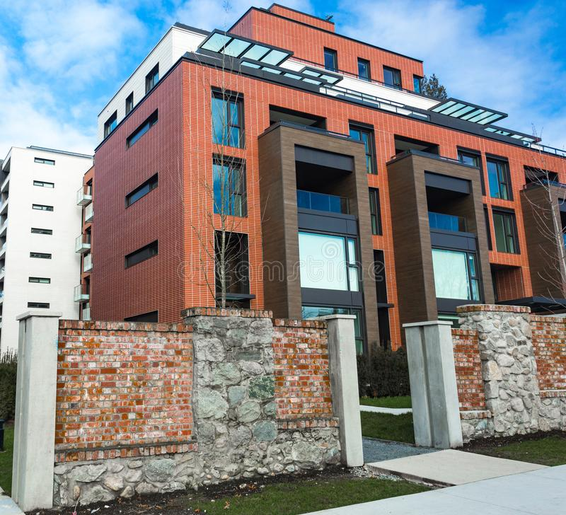 Free Low Angle View On Modern Residential Brick Apartment Building Exterior With Large Windows. Modern Apartment Complex Under Stock Image - 140013441