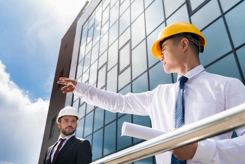 professional architects in formal wear working at modern office stock images