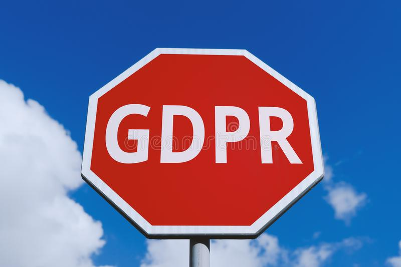 Low angle view of road sign stop with GDPR. Low angle view of warning road sign stop with GDPR symbol against blue sky. General Data Protection Regulation GDPR royalty free stock photo
