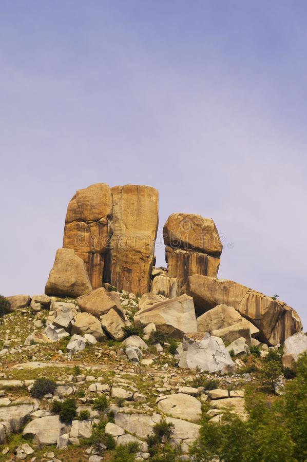 Low angle view of rock formations on top of a hill