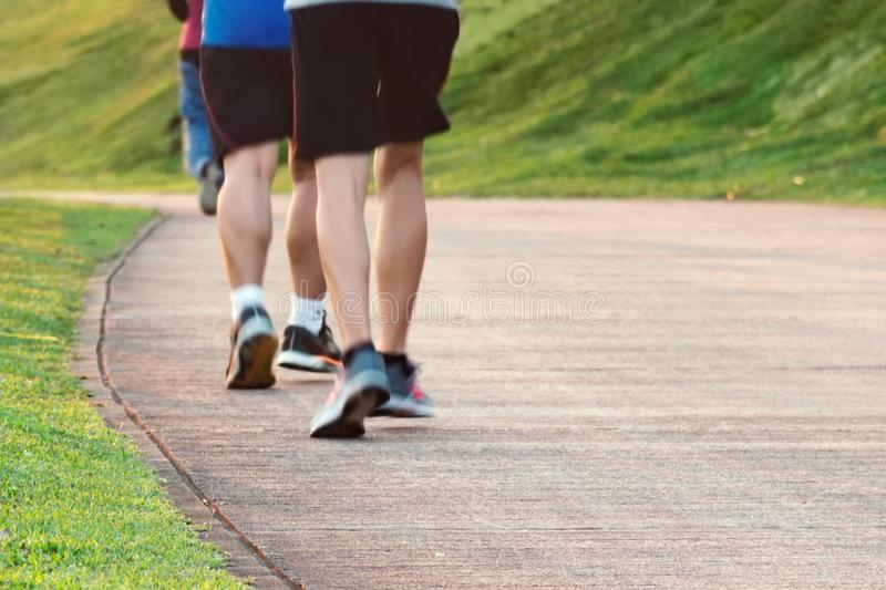Blurred feet motion group of runners, Fitness and healthy lifestyle, outdoor sport activity. stock photo
