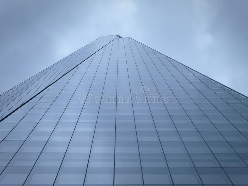 Low angle view of the Shard against cloudy sky. Low angle view of the Shard against cloudy sky, London, UK royalty free stock photos