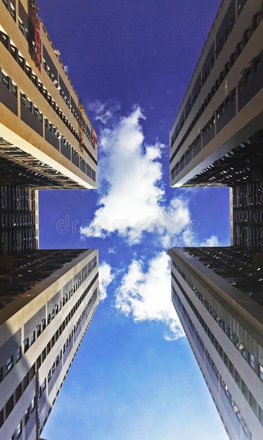 Low Angle View of Skyscraper Against Cloudy Sky royalty free stock photography