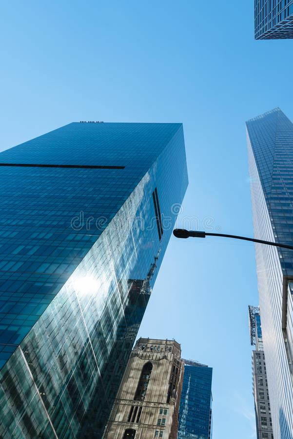 Low angle view of skyscrapers against sky in New York City. Low angle view of skyscrapers against sky in Midtown of Manhattan stock image