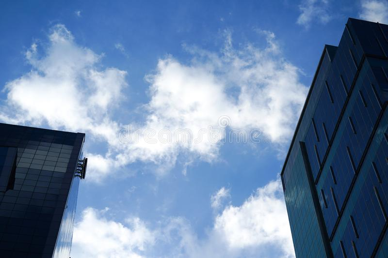 Low angle view of skyscrapers Business Office with blue sky, Cor stock photos