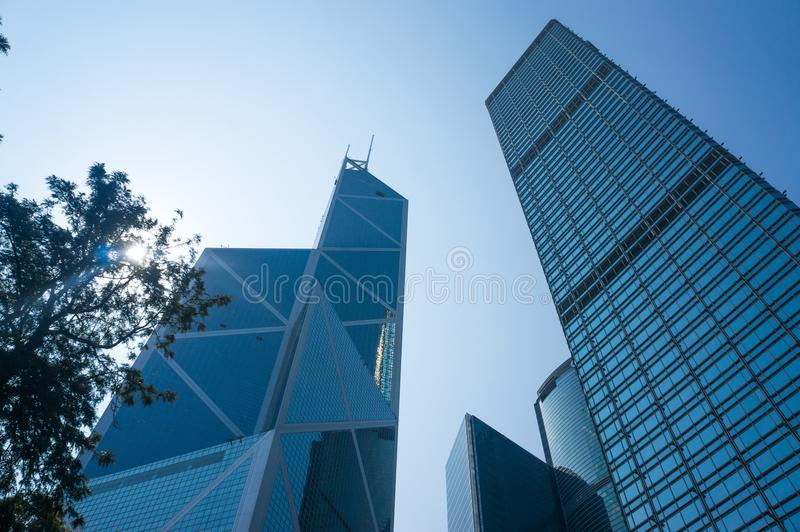 Low angle view of skyscrapers in Hong Kong, toned image of modern office building. stock image