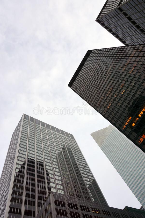 A low angle view of skyscrapers in New York City in a cloudy day stock photo