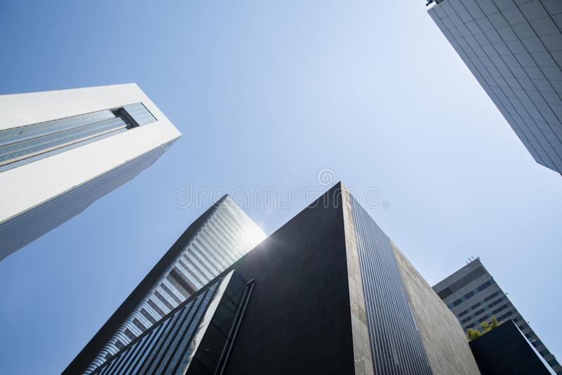 Low angle view of skyscrapers in Seoul. Business city architecture building cityscape downtown finance high modern office tower urban center district exterior stock photos