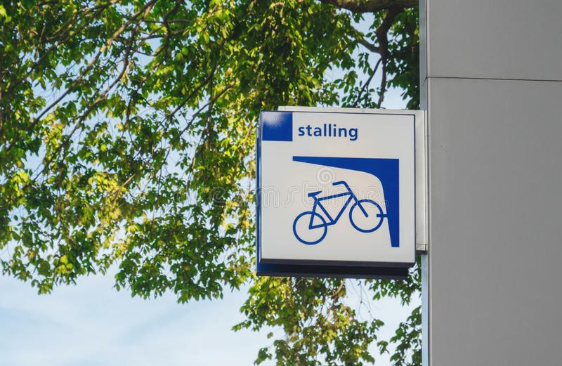 Low angle view of Stalling sign parking bicycle royalty free stock photo