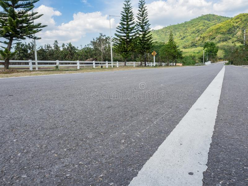 Low angle view street in the country of Thailand. Perspective view street to the mountain royalty free stock photo