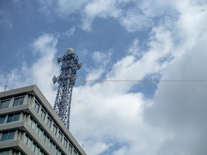 Telecommunication tower with radio transmitting equipment stock photography
