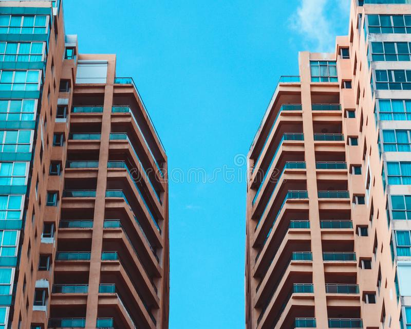 Low Angle View of Two High Rise Buildings Under Blue Sky royalty free stock photo