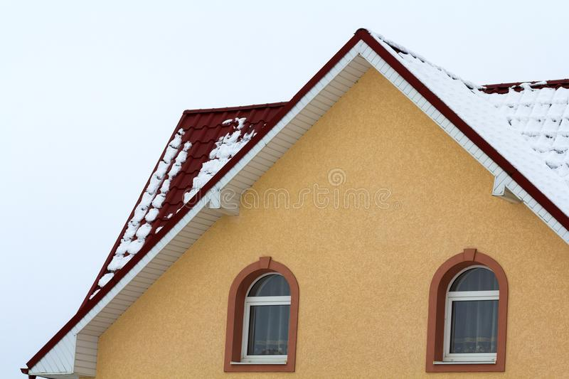 Low angle view of the upper floors of a new large house. Window and roof detail of residential home building. Real estate property royalty free stock photos