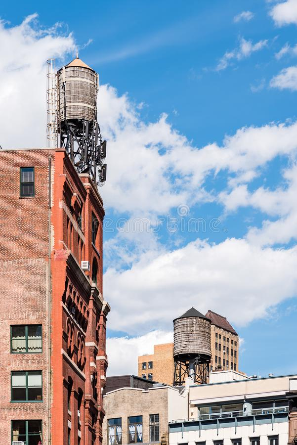 Water tanks in Tribeca in New York. Low angle view of water tanks in Tribeca North District of New York City royalty free stock image