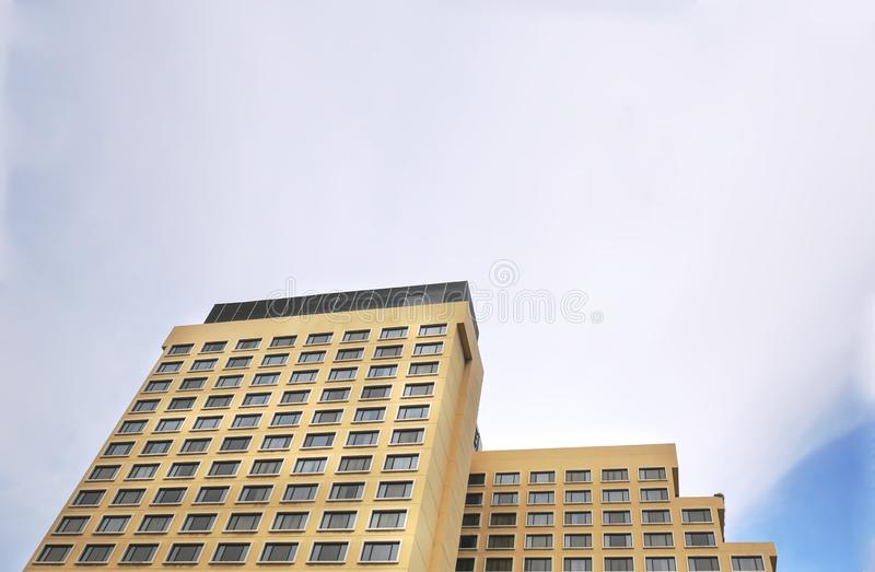 Low Angle View of Modern Building Against Sky. Low Angle View of Yellow Modern Building Against Sky stock images