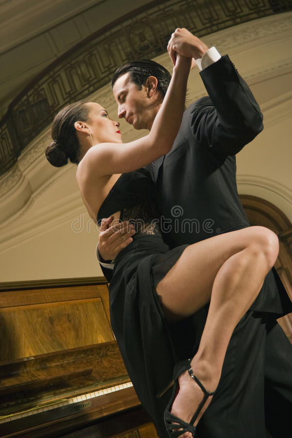 Low angle view of a young couple dancing stock images