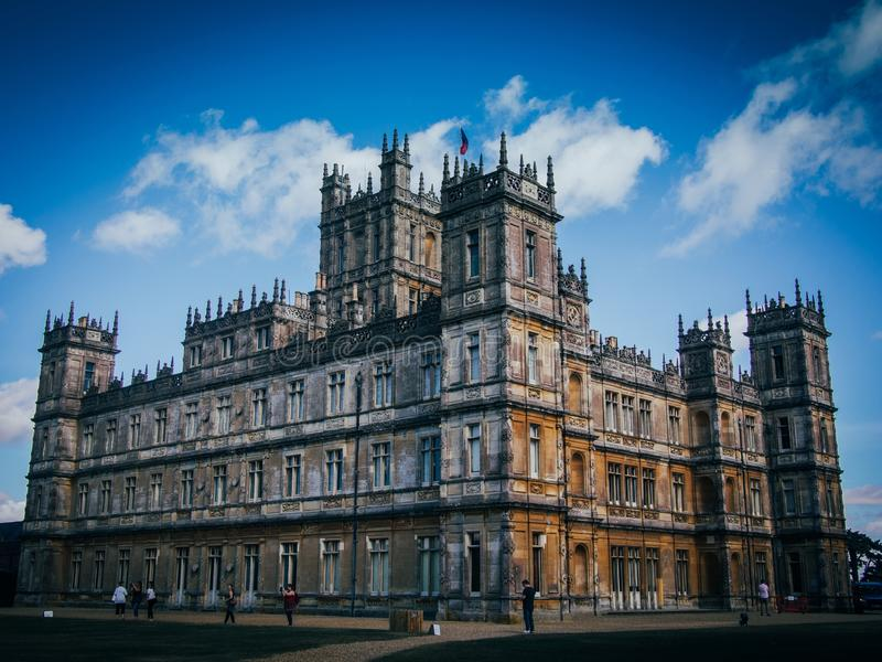 Low angle wide shot of the Highclere Castle on a sunny day stock photos