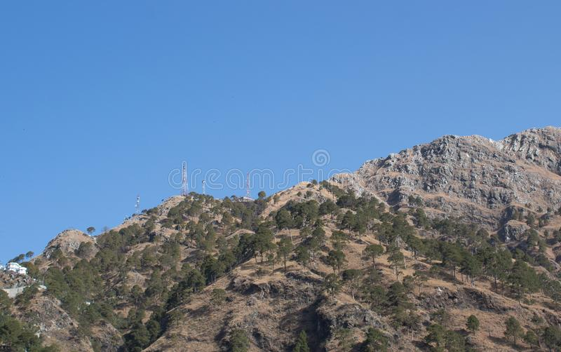 Low angle wide shot of a mountain top with telephone towers. Telecommunication concept. Across, aerial, view, agriculture, areal, beautiful, beauty, blue royalty free stock photos