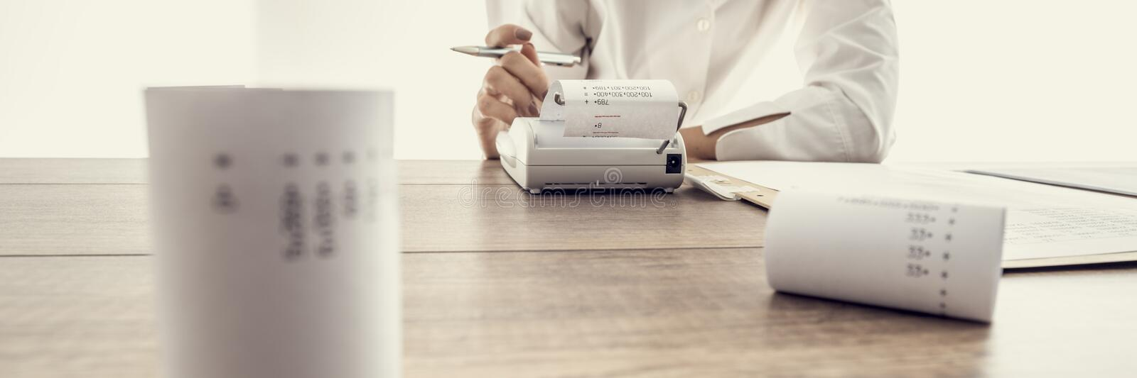 Low angle wide view of a woman doing calculations royalty free stock photos