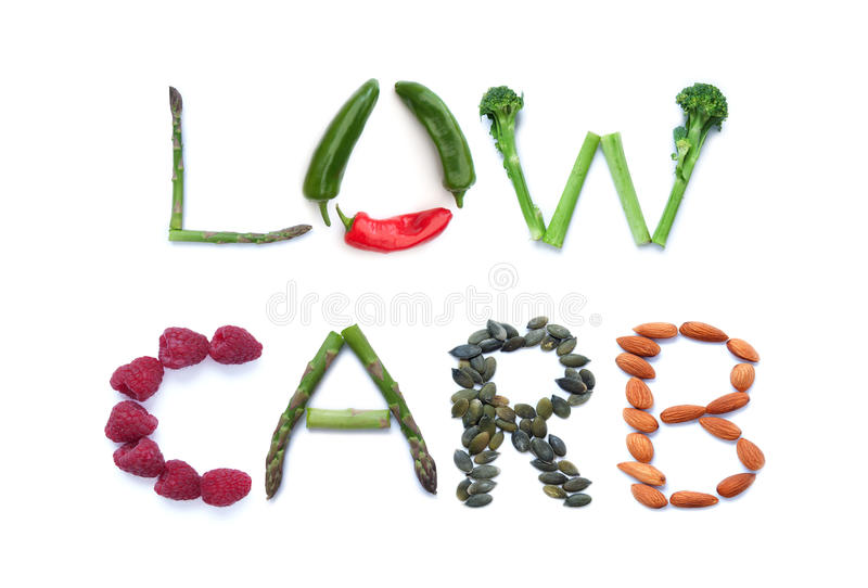 Low carb diet. Fruits, vegetables and seeds spelling the word low carb royalty free stock images