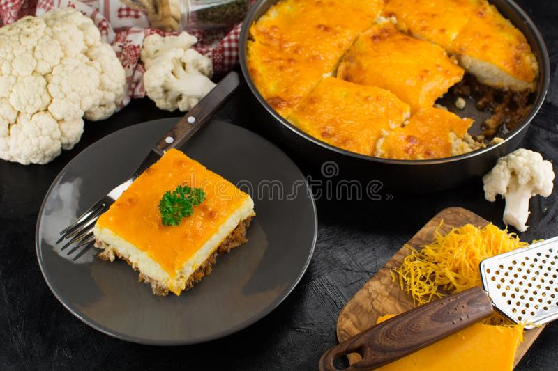 Low-Carb Keto Diet Shepherd`s Pie with Cauliflower Base, Sauteed Meat and Cheddar. A set of photos showing an entire recipe preparation with instructions and royalty free stock images