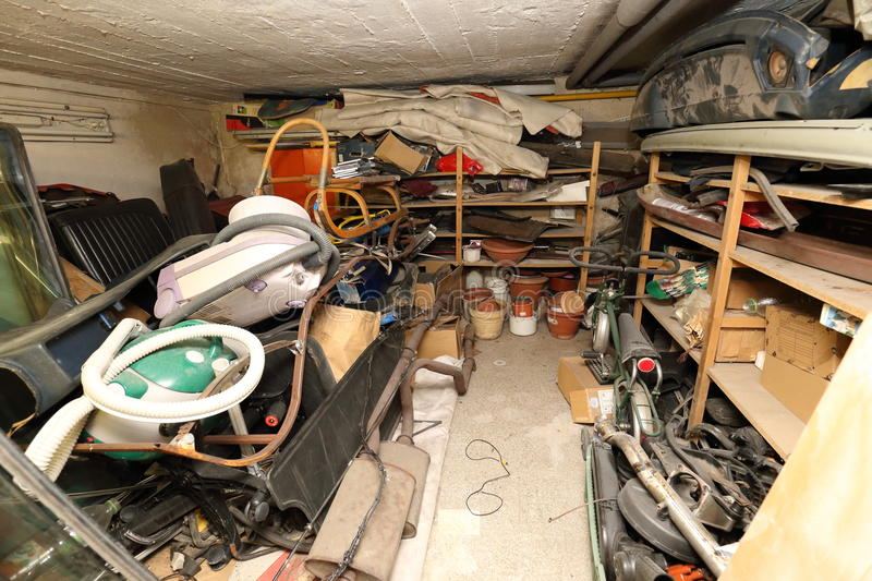 Low cellar full of trash, old vacuum cleaners royalty free stock photography