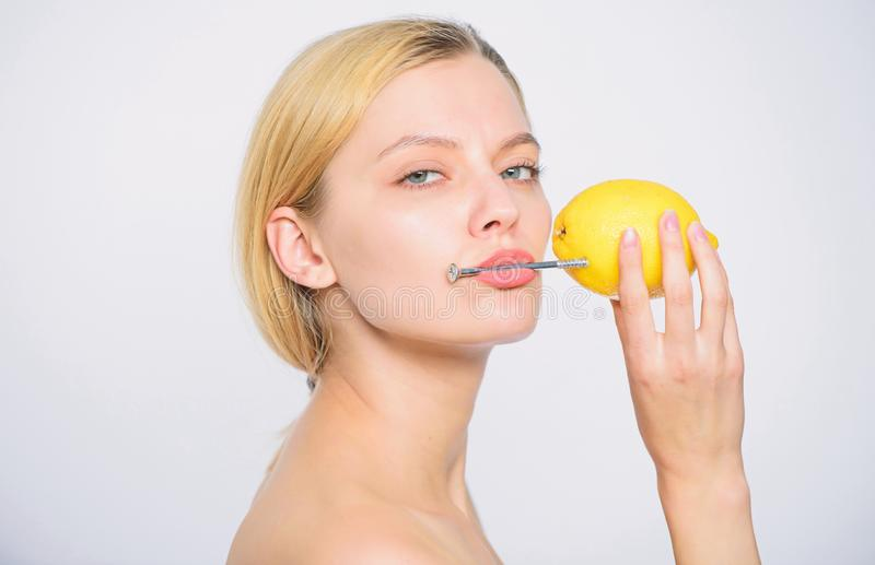 Low charge. Recharge your body vitamins. fresh fruit juice. lemon battery. woman with hobnail at lemon. skincare. Healthy skin. energy and positive mood. girl stock photos