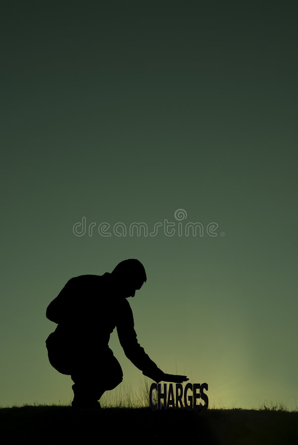 Low charges concept. Low Charges. Man holding his hand on the CHARGES word royalty free stock photography