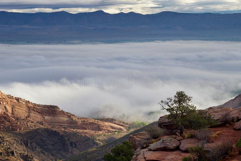 Low Clouds Due to Temperature inversion. A temperature inversion is keeping clouds low in the Grand Valley. Colorado National Monument offers spectacular views royalty free stock photo