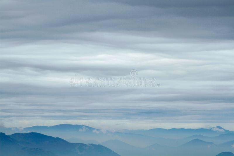 Low clouds, marine layer, cloud inversion over Cascades Mountains, Carpenter Mountain, Willamette National. Low clouds, marine layer, cloud inversion over royalty free stock photos