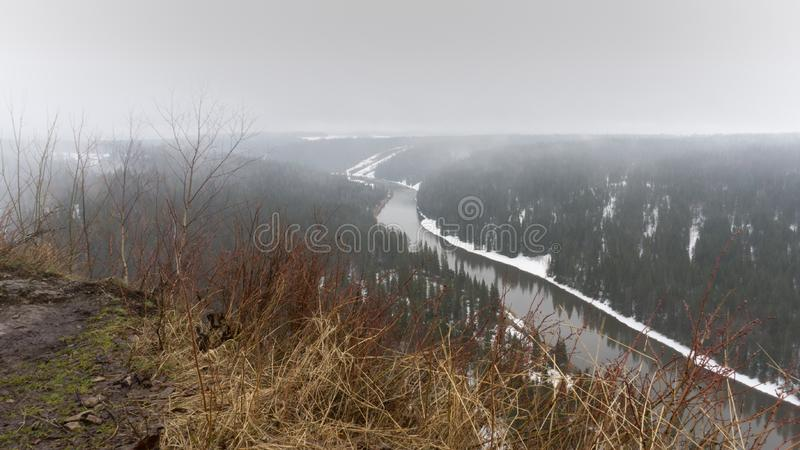Low clouds over the Ural mountains. Snow, spring, plant, riiver, forest, taiga, trees, fog royalty free stock photos