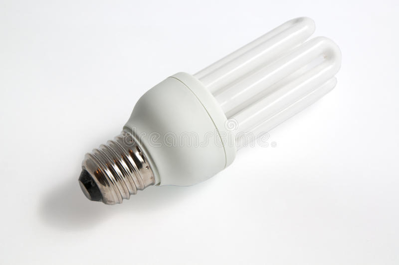 Low consume lamp. Isolated low consume lamp on white background stock photos