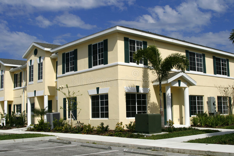 Download Low- cost condos stock photo. Image of cloudy, trim, condos - 2646002