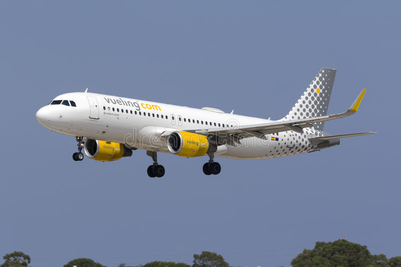 Low-Cost Spanish carrier Vueling A320. Luqa, Malta July 19, 2017: Vueling Airlines Airbus A320-214 [REG: EC-LVO] landing runway 31, arriving from Barcelona stock images
