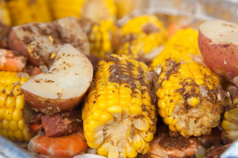 Low Country Boil. A traditional low country boil with red potatoes, corn on the cob, and shrimp. Everything is seasoned to perfection with cajun spices royalty free stock photography