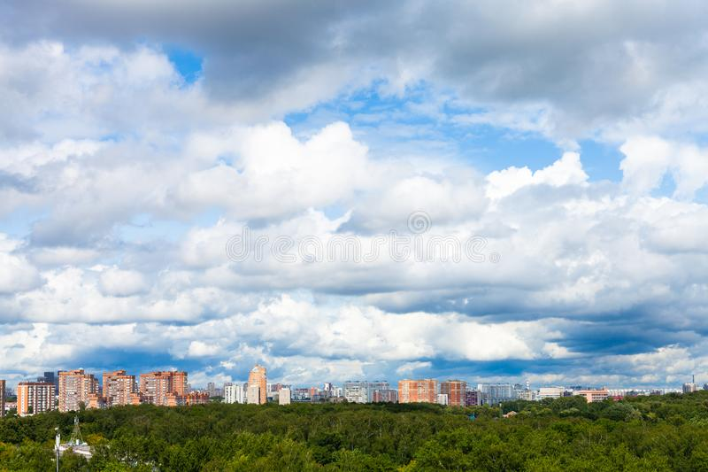 low dense white clouds in blue sky over city royalty free stock image