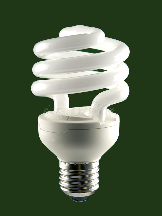 Low energy Bulb. On green background stock image