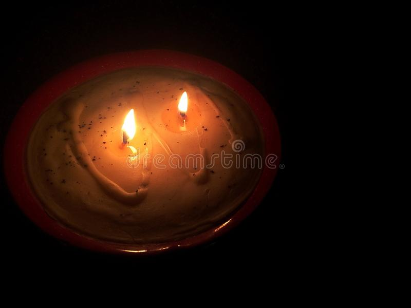 A low flame in a dark room royalty free stock photos