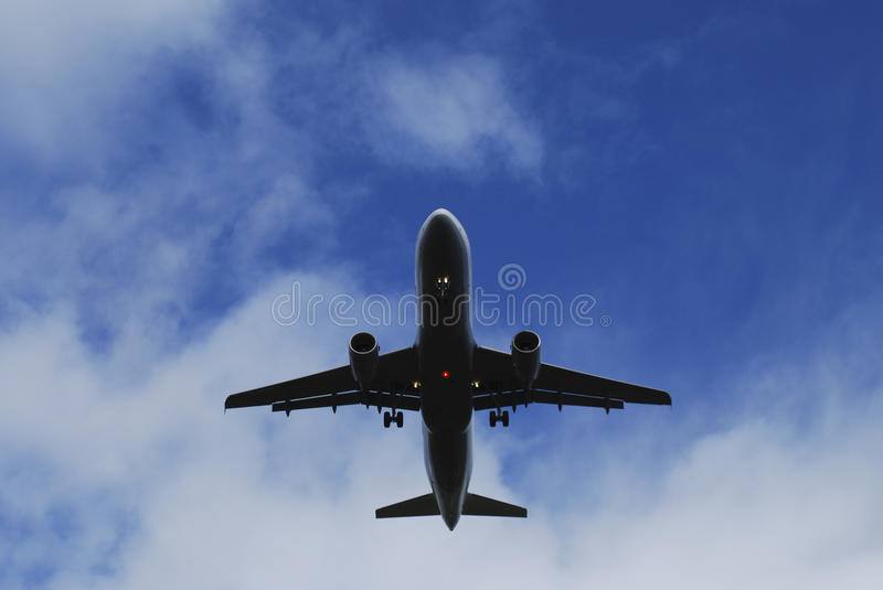 Low flying jet royalty free stock photo